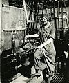 Woman turning shell in lathe.jpg