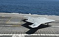 X-47B makes its first arrested landings aboard ship (9255999895).jpg