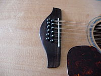 Yamaha FG720S-12 bridge with Bone Saddle & Ebony Bridge Pins Installed