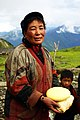 Yunnan woman with yak cheese.jpg