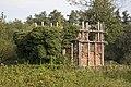 Zicht op kasteelruïne Ouborgh met houtconstructie gestut, deels overwoekerd met planten - Swalmen - 20429617 - RCE.jpg