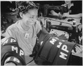 """Insignia for military police are being turned out in an eastern quartermaster corps depot where this young worker has o - NARA - 535807.tif"
