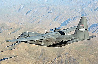 136th Airlift Squadron - A C-130 Hercules from the 136th Expeditionary Airlift Squadron flies over rugged Afghan landscape on its way to delivering much-needed supplies to a forward operating base in Oruzgan Province, Afghanistan,