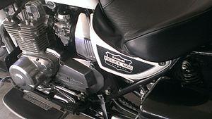 Kawasaki police motorcycles - Left side 2002 KZ1000p showing engine, left footboard, seat, carburetors and side panel.