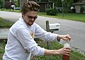 2008-09-20 Brewmaster Nate opens another bottle of homebrew.jpg