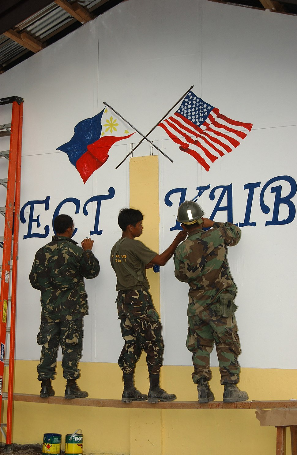 2 Filipino soldiers painting friendship flags 070217-N-4198C-001 0V7HO
