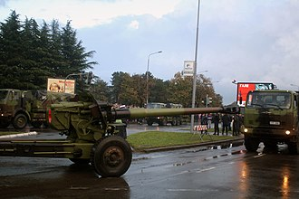 """Gun-howitzer M84 NORA - Serbian Army FAP 2026BS/AV 6x6 trucks towing M-84 Nora-A 152 mm gun-howitzers during the military parade """"March of the Victorious"""" on the occasion of marking 100 years since the beginning of the Great War and 70 years since the liberation of the capital in the Second World War."""