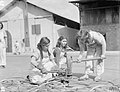 ALLIED WOMEN REPAIR NAVAL GEAR IN MEDITERRANEAN PORT. 6 AND 7 OCTOBER 1943, BEIRUT. SOME 150 GIRLS OF LEBANESE, ARMENIAN, GREEK, AND OTHER NATIONALITIES ARE WORKING FULL TIME FOR THE ROYAL NAVY. CLEANING AND PA A20007.jpg