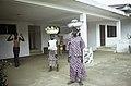 ASC Leiden - F. van der Kraaij Collection - 13 - 045 - Fruit vendors carrying enamel bowls on their heads with pineapple and watermelon - Monrovia, Old Road, Montserrado county, Liberia - 1975.jpg