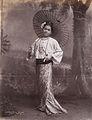 A Burmese Beauty with Japanese umbrella in 1906.jpg