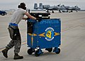 A U.S. Airman assigned to the 355th Aircraft Maintenance Squadron moves a tool box after preparing an A-10 Thunderbolt II aircraft for a sortie during the Combat Hammer air-to-ground weapon system evaluation 140219-F-OC707-104.jpg