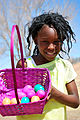 A child collects eggs at an Easter egg hunt March 30, 2013, at Unity Park at Cannon Air Force Base, N.M. More than 400 children participated in the hunt, gathering more than 3,000 hidden eggs 130330-F-KB862-111.jpg
