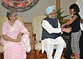 A child tying 'Rakhi' to the Prime Minister, Dr. Manmohan Singh, on the occasion of 'Raksha Bandhan', in New Delhi on August 24, 2010.jpg
