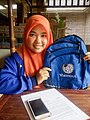 A masters student of Mathematics shows off her Wikipedia backpack in Bandung, Indonesia. May 5, 2017.jpg
