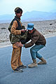 A member of the Afghan Uniformed Police searches a local at a traffic checkpoint, in the Nazyan district, Nangarhar province, Afghanistan, March 10, 2012 120310-A-LP603-184.jpg
