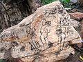 A stone engraved with bhakta posture Gaaligopuram Tirumala Tirupati.JPG