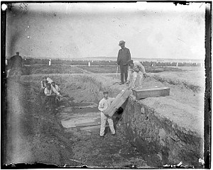 Potter's field - A trench at the potter's field on Hart Island, New York, circa 1890 by Jacob Riis.