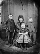 A woman and three children NLW3364736.jpg