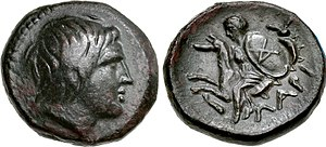 Achilles - Head of Achilles depicted on a 4th-century BC coin from Kremaste, Phthia. Reverse: Thetis, wearing and holding the shield of Achilles with his AX monogram.