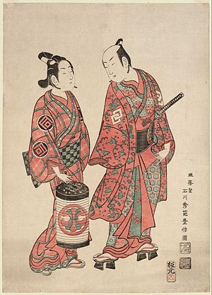 Wakashū - Woodblock print by Ishikawa Toyonobu, c. 1740, showing two actors portraying a wakashū (left) and an adult man (right). Note the difference in hairstyle.