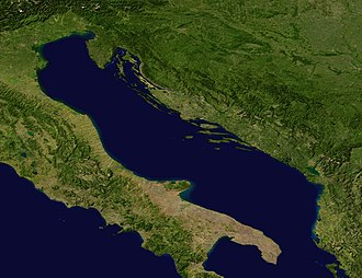 Acqua alta - A satellite image of the Adriatic Sea, highlighting the long and narrow rectangular shape which is the source of an oscillating water motion (called seiche) along the minor axis. The oscillation, which has a period of 21 hours and 30 minutes and an amplitude around 0.5 meters at the axis' extremities, supplements the natural tidal cycle, so that the Adriatic sea experiences much more extreme tidal events than the rest of the Mediterranean.