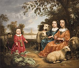 Three girls with sheep in a landscape