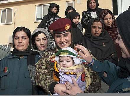 Afghan army and police officials wearing hijabs in Kandahar Afghan National Army (ANA) Brig. Gen. Khatool Mohammadzai, center, the director for women's affairs and the deputy director for the education and physical training within the ANA, poses with a group of 120220-A-WI966-673.jpg