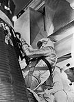 Alan Shepard is being inserted into the Freedom 7 capsule.jpg