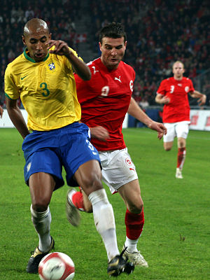 Alexander Frei - Frei battling for the ball from Brazil's Luisão in a November 2006 friendly