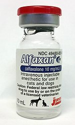 Bottle of Alfaxan; contains an opaque white liquid