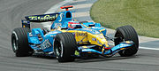 Fernando Alonso driving for Renault F1 at Indianapolis in 2005, the year in which the team won their first Formula One championship.