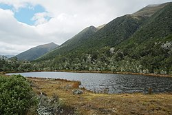 Alpine tarn on Lewis Pass in front of Spenser Mountains.jpg