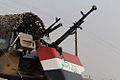 An Iraqi soldier of the 9th Iraqi Army Division (Mechanized) pulls security from his turret outside of an election site in Solmon Pak, Iraq 2.JPG
