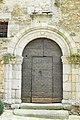 Ancien Hôpital de Saint-Léonard-de-Noblat - porte en plein cintre à double voussure de style limousin.JPG
