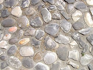 Cobblestone Natural building material based on cobble-sized stones, used for pavement roads, streets, and buildings