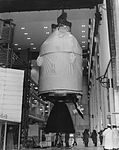 Apollo 12 command and service modules hoisted above test stand.jpg