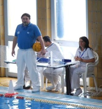 Rules of water polo - A water polo referee standing in front of the table officials.