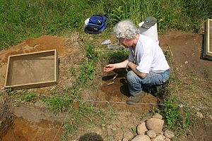 Kenneth Feder - Ken Feder recovering the tip of a stone spearpoint at a 1,000-year-old archaeological site in West Simsbury, Connecticut.