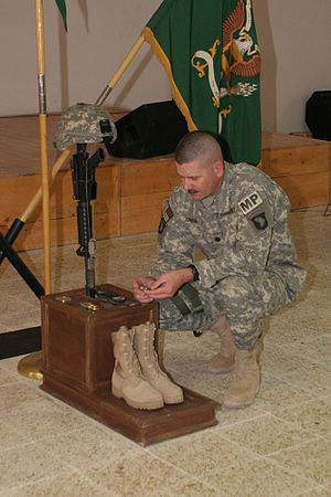 42nd Military Police Brigade (United States) - A 42nd MP Brigade soldier mourning a fallen comrade at a ceremony in Iraq in 2008