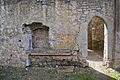 Athassel Priory St. Edmund Choir South Wall Tomb Niche 2012 09 05.jpg