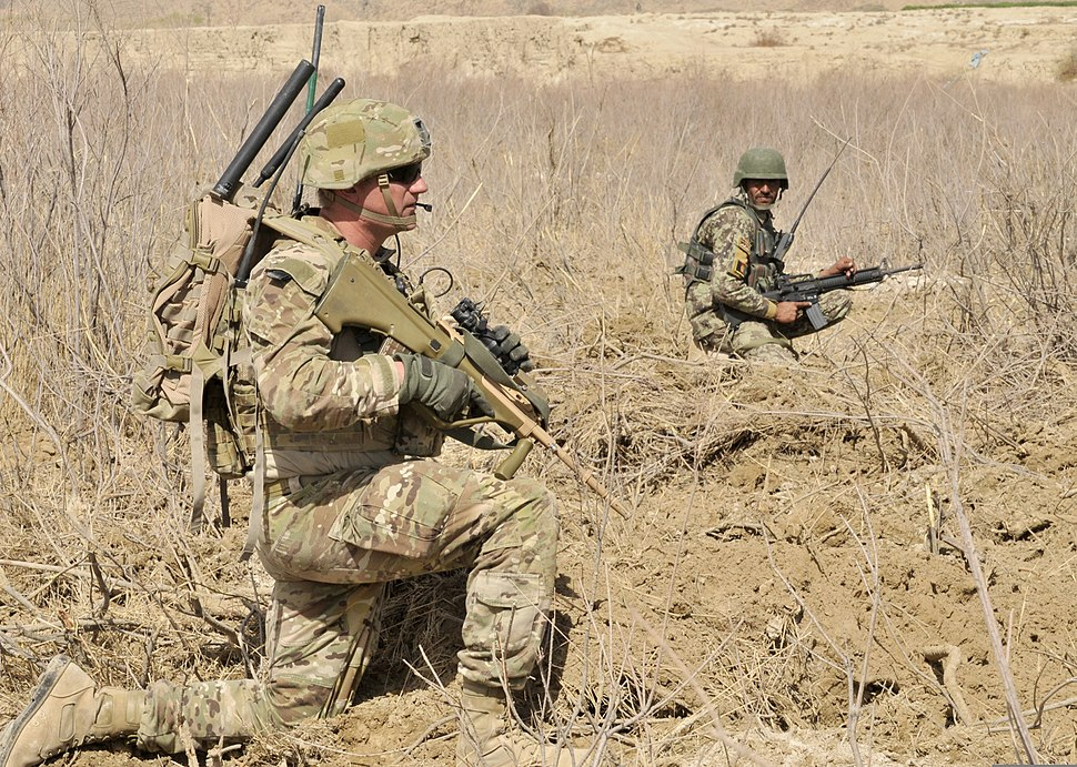 Australian Army Cpl. Andrew Guyer, left, and an Afghan National Army soldier provide security during Operation Southern Fist III in the Spin Boldak district, Kandahar province, Afghanistan, March 5, 2013 130305-A-MX357-226