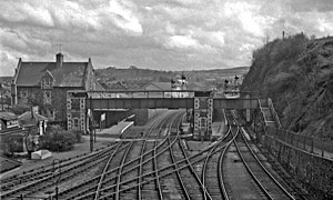 Ilfracombe branch line - Barnstaple Junction station in 1964, looking towards Exeter from the road bridge. The tracks entering from the left mark the southern end of the Ilfracombe branch; those in the foreground lead to Bideford.