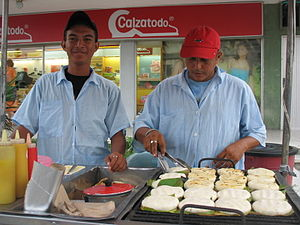 Arepa - Street vendor selling grilled arepas on bijao leaves in Barranquilla.