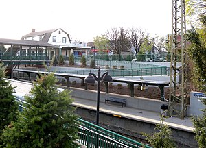 Bayside (LIRR station) - View of Bayside station house and pedestrian bridge from above the eastbound ramp.