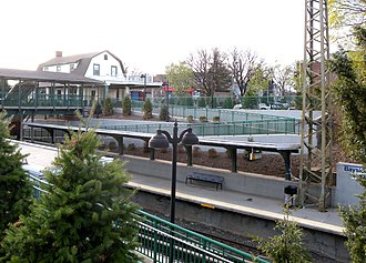 Bayside station (LIRR) - View of Bayside station house and pedestrian bridge from above the eastbound ramp.