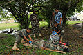 Belize Defence Force combat medics, Cpl. Paul Shal and Lance Cpl. Leon Lopez, right, provide medical attention to a field casualty role player, while being observed by Belize Defence Force and U.S. Army 100830-A-CL600-033.jpg