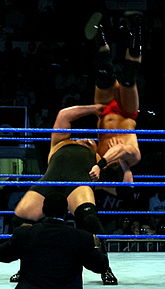 The Big Show performs a Vertical suplex on JBL during a house show.