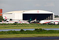 Biman Bangldesh Airlines Hanger when the newly painted A310 S2-ADK just arrived. S2-AFP was passing by it (8157510707).jpg