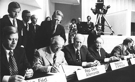 Chancellor of the Federal Republic of Germany (West Germany) Helmut Schmidt, Chairman of the State Council of the German Democratic Republic (East Germany) Erich Honecker, U.S. president Gerald Ford and Austrian chancellor Bruno Kreisky signing the Helsinki Act Bundesarchiv Bild 183-P0801-026, Helsinki, KSZE-Konferenz, Schlussakte.jpg