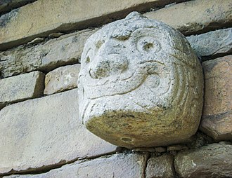 Peru - Sculpted Chavin head embedded in one of the walls of the temple of Chavín de Huantar.